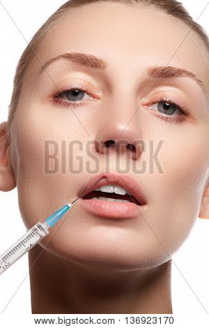 Portrait Of Young Woman Getting Cosmetic Injection. Beauty
