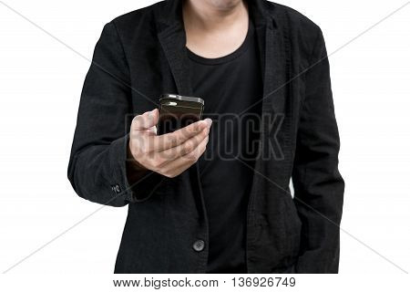 Businessman wearing a black suit typing on smartphone screen