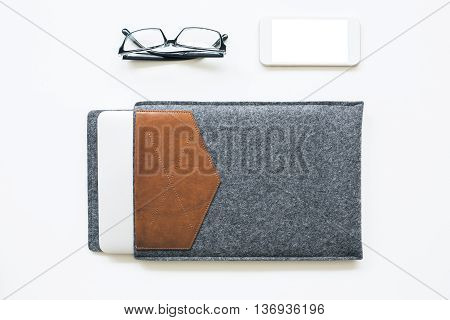 Closed Laptop And Phone