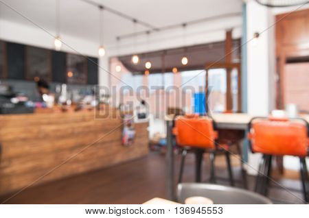 Blurred coffee shop interior to use as background or template