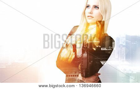 Pretty thoughtful businesswoman on New York city background with sunlight. Double exposure