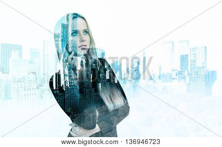 Attractive thoughtful businesswoman on New York city background. Double exposure