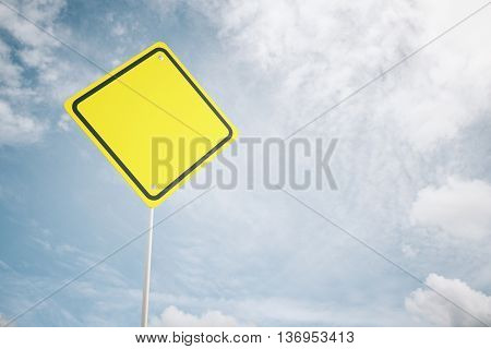 Blank yellow warning road sign on sky background. Mock up 3D Rendering