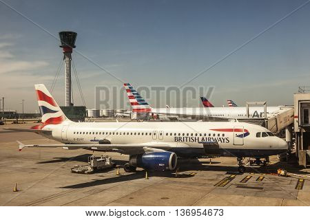 LONDON UK - APR 20 2016: British Airways airplanes at the terminal of London Heathrow international airport. Hillingdon England United Kingdom.