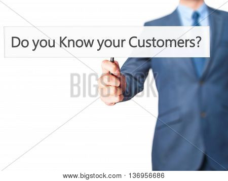 Do You Know Your Customers ? - Businessman Hand Holding Sign