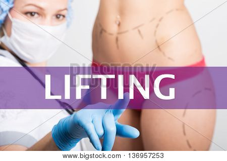 lifting written on a virtual screen. Internet technologies in medicine concept. medical doctor presses a finger on a virtual screen. cosmetic surgery, lifting and breast augmentation.
