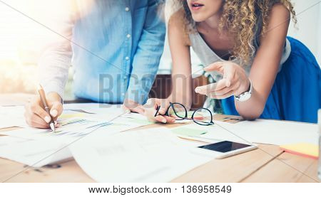 Coworkers Team Work Process Modern Office Loft.Account Managers Produce New Idea Project.Young Business Crew Working Startup.Smartphone Wood Table.Analyze Market Reports.Blurred, Film Effect.Horizontal