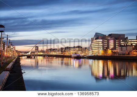 Dublin City Center during sunset with Samuel Beckett Bridge and river Liffey