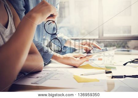 Successful Account Managers Team Analyze Business News Modern Interior Design Loft Office.Coworkers Using Contemporary Tablet.Sharing Information.Blurred Background.New Startup Idea Process Closeup