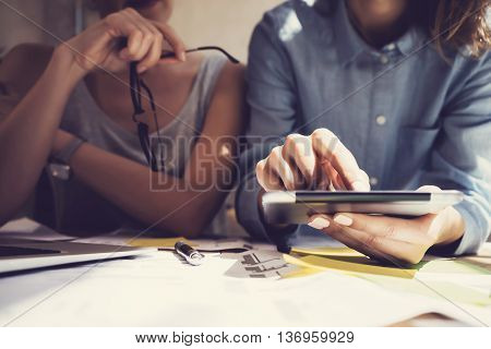 Working Time Modern Studio Loft.Girl Touching Display Digital Tablet Hand.Project Producers Researching Process.Crew Work New Business Startup.Analyze market stock reports.Blurred effect.Horizontal