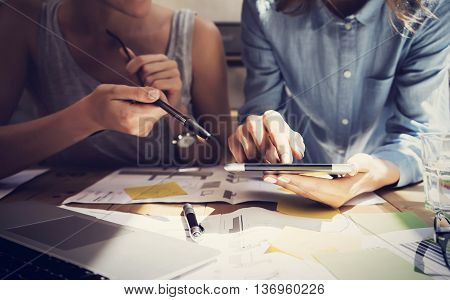 Woman Touching Display Digital Tablet Hand.Project Manager Researching Process.Business Team Working Startup modern Coworking.Analyze market stock.Using electronic device, paper, note wood table.Blurred