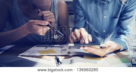 Closeup photo Girl Touching Screen Digital Tablet Hand.Project Producer Researching Process.Business Crew Working New Startup modern Studio.Analyze market stock, strategy.Blurred, film effect.Horizontal