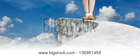Women leg walking back from dead end on high way footpath or top of wall and cloudy sky view background