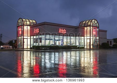 DALLAS Tx USA - APR 17 2016: Arby's restaurant building illuminated at night. Arby's is the second largest sandwich chain in the U.S. with more than 3400 restaurants