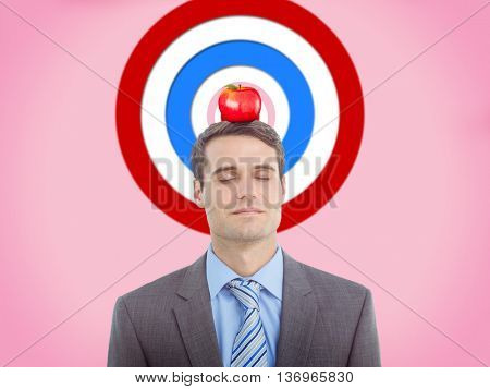 Handsome businessman with eyes closed against pink background