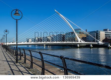 DUBLIN, IRELAND - 14 APRIL 2015: Samuel Beckett Bridge crossing the River Liffey in Dublin Ireland