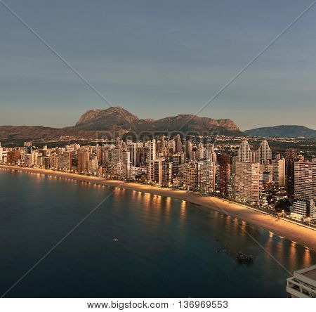 Aerial view of a Benidorm city coastline at sunrise. Benidorm is a modern resort city one of the most popular travel destinations in Spain. Costa Blanca Alicante province