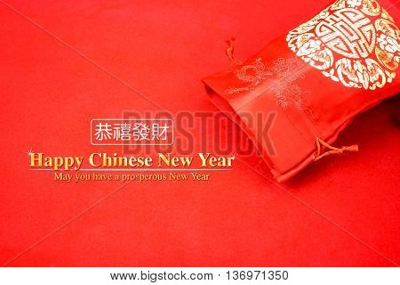 Chinese New Year : Red Fabric Packet Or Ang Pow With Happy Chinese New Year Word On Red Felt Fabric,