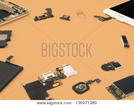 Smart phone components isolate on orange background with copy space
