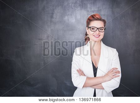 Beautiful Smiling Teacher On Blackboard Background