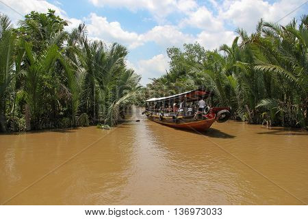 Mekong Delta Vietnam. April 25.2014. Tourist boat floats on the channel in Mekong Delta