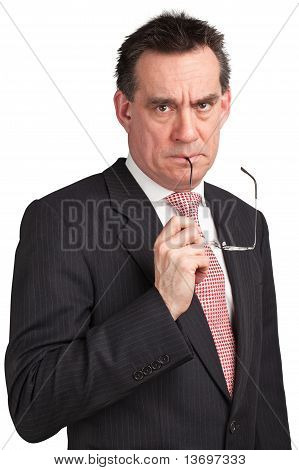 Frowning Businessman Holding Glasses to Mouth