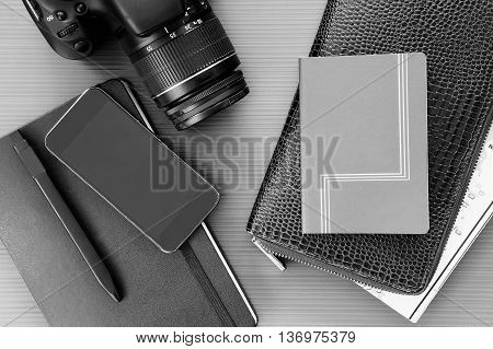 Still life of cell camera notebook pen and wallet in close-up on table