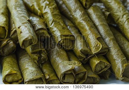Rolled turkish dolma ready for cooking. it is rolled with vine leaves