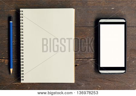 Top View Above Notebook And Pencil With Phone On Wood Table