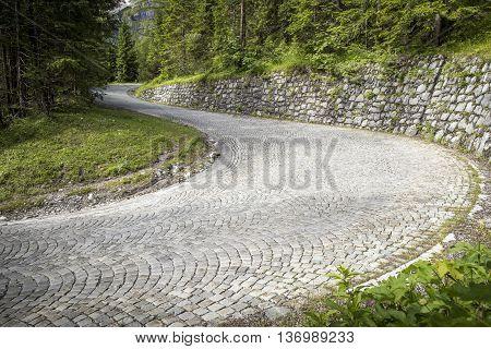 Winding mountain pavement road - a turn