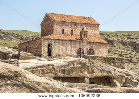 Ancient Orthodox Church in antique cave city Uplistsikhe Georgia.
