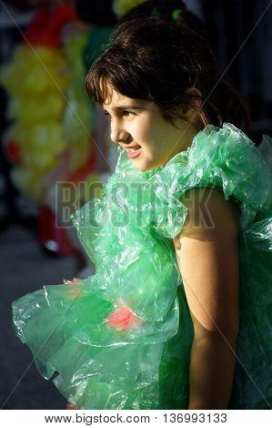 Montenegro, Herceg Novi - 04/06/2016: Girls in fancy dress of green polyethylene bags. 10 International Children's Carnival