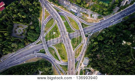 Aerial view of highway interchange of a city. Top view, from above. Outdoor.