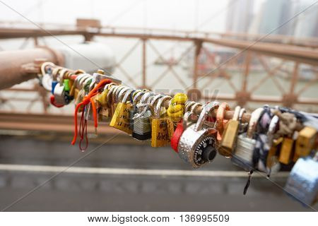 NEW YORK - CIRCA MARCH, 2016: love locks on the Brooklyn Bridge. The Brooklyn Bridge is connects the boroughs of Manhattan and Brooklyn by spanning the East River.