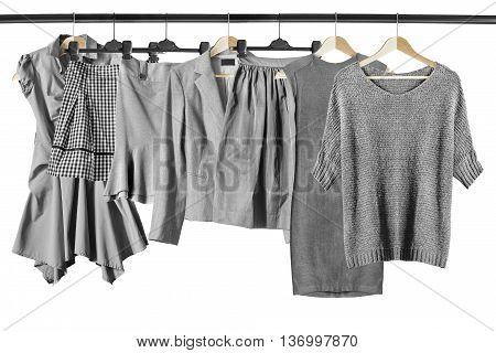 Set of gray clothes on clothes racks isolated over white