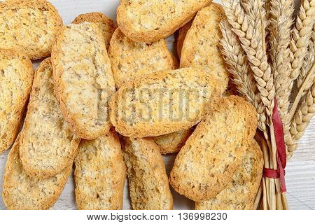 slices of toasted bread with ears of wheat