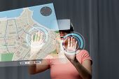 technology, virtual reality, cyberspace, entertainment and people concept - happy young woman with virtual reality headset or 3d glasses at home looking at gps navigator map projection poster