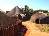 Traditional Zulu straw huts rondavels. Tribal ethnic style. Village in KwaZulu-Natal South Africa. Artistic retouching. poster