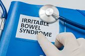 Blue folder with patient files with IBS (Irritable Bowel Syndrome) diagnosis. poster