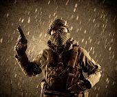 Portrait of dangerous heavily armed terrorist soldier with mask on grungy rainy background  poster