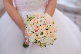 beautiful wedding bouquet in bride hands close up