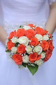 wedding bouquet of white and orange rose