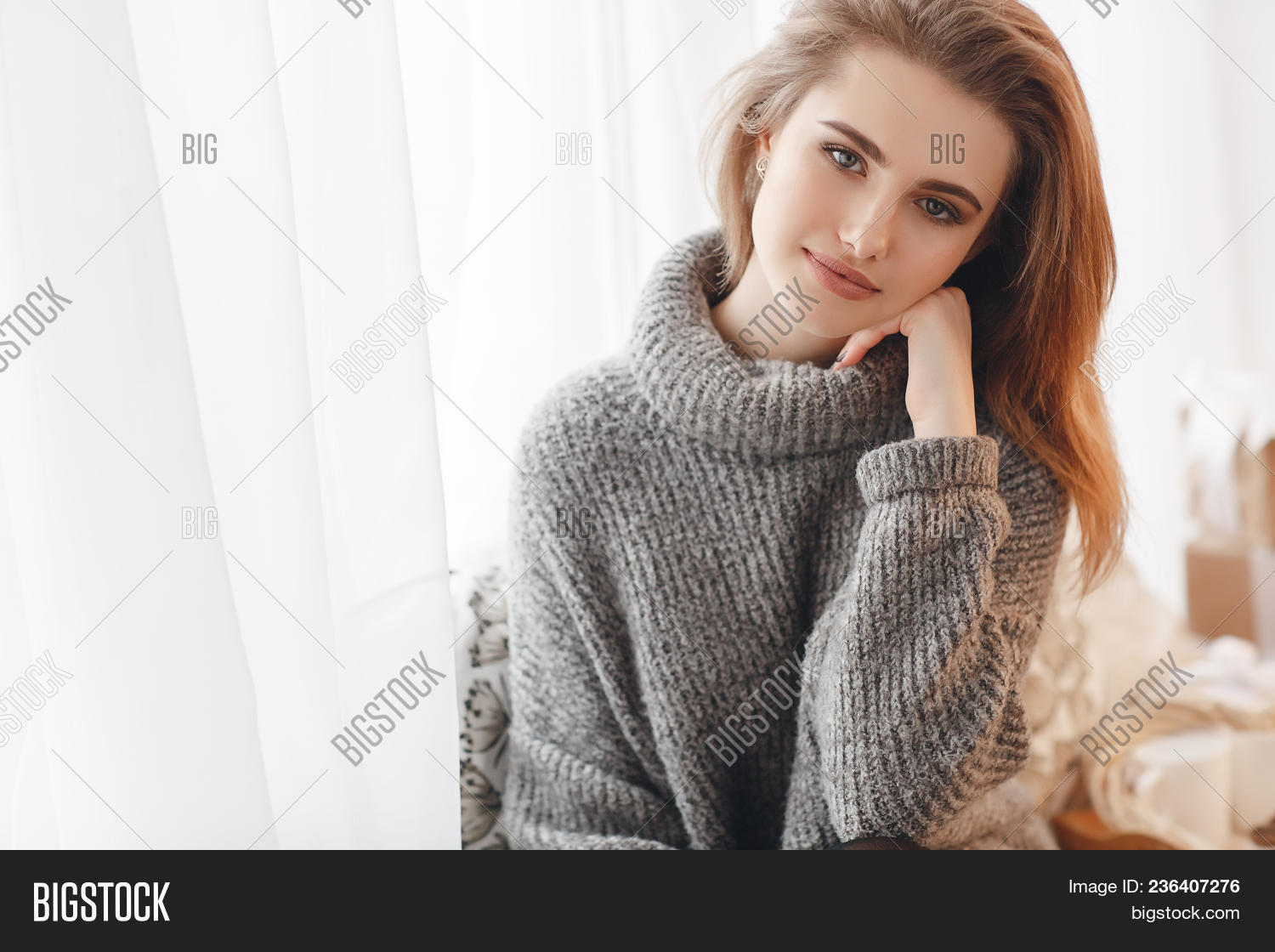 Beautiful Sexy Girl In An Elegant Gray Sweater. Close-up, Portrait Of A