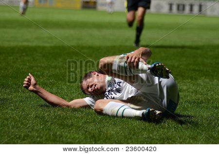 KAPOSVAR, HUNGARY - SEPTEMBER 10: Milan Peric injured at a Hungarian National Championship soccer game - Kaposvar (white) vs Gyor (green) on September 10, 2011 in Kaposvar, Hungary.