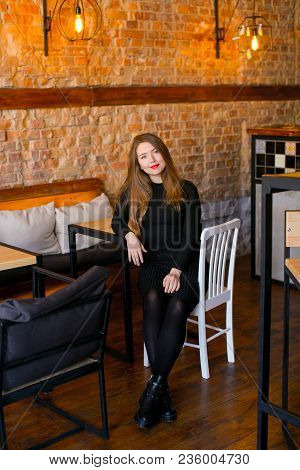 Ladies Went To Coffee House, Smiling Fair-haired Girl With Black Scrunchy On Hand Wearing Sitting Ne