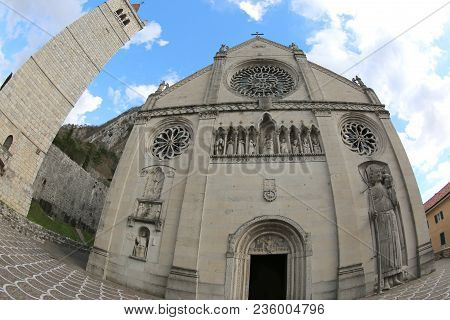 facade of ancient Cathedral in Gemona del Friuli in Northern Italy. The Church was destroyed by an earthquake in 1976. Photo by fisheye lens poster