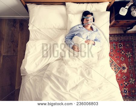 Woman sleeping with an anti-snoring mask