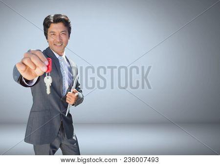 Businessman Holding key in front of vignette
