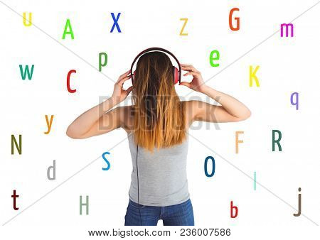 young woman listening music with colour letters around. White back.