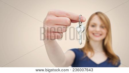 Woman Holding key in front of vignette